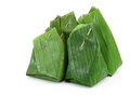 Thai dessert wrapped in banana leaves Stock Photos