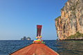 The Thai excursion boat floats to ocean island Stock Photo