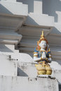 Thai fairy sculpture sit on the pagoda Stock Photos