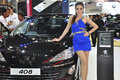 A Thai female presenter next to a Peugeot 408 Stock Photos