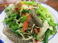 Thai fish skin salad some on a plate in asia Stock Photography