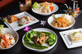 Thai food dishes variety shrimp scampi seafood dish with broccoli and asparagus and a of other Stock Photos