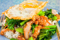 Thai food, kana moo krob.(fried kale mixed crispy pork and egg) Royalty Free Stock Photo