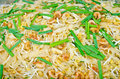 Thai food pad thai stir fry noodles shrimp omelet preparation serving Stock Photos