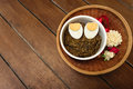 Thai food pound eggplant with boiled egg on wood table Royalty Free Stock Photo