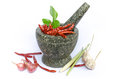 Thai foodstuffs in mortar inclute chilli garlic onion lamon grass and spices Stock Images