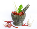 Thai foodstuffs in mortar inclute chilli garlic onion lamon grass and spices Royalty Free Stock Images