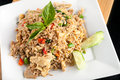 Thai fried rice with chicken a dish of presented on a square white plate Stock Images