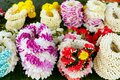 Thai garlands and amulets of flowers for religious ceremonies and offerings to spirits Royalty Free Stock Photo