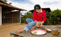 Thai girl removing coconut meat from shell Stock Images