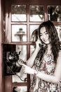 Thai girl is talking with an old-fashion phone in black and whit Royalty Free Stock Photo