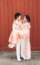 Thai groom carrying cute bride in happiness asian is his smiling face Stock Photos
