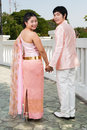 Thai groom holding bride s hand in happiness asian is his beside white bridge Royalty Free Stock Photography