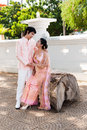 Thai groom looking cute bride in happiness asian is his smiling face Stock Photo