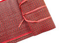 Thai handicraft red mat on white background Royalty Free Stock Photos