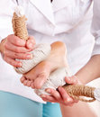 Thai herb compress massage of leg. Royalty Free Stock Photo