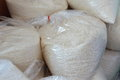 Thai jasmine rice paddy packing in plastic bag collect on warehouse Royalty Free Stock Photo