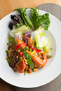 Thai jumbo shrimp salad on a round white plate shallow depth of field Royalty Free Stock Photos