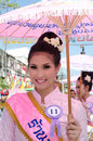 Thai Lady smile in parade of pedal a bicycle. Stock Photo