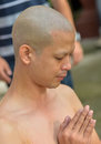 An thai male sit for ordain ritual bangkok thailand october buddhism have a shower to clean body at wat thapra temple in thonburi Stock Image