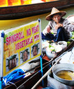 Thai man cooking damnoen saduak floating market thailand Royalty Free Stock Image
