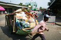 Thai man pulls a cart, Thailand. Stock Photo