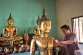 Thai man try to patch a golden foil at the statue of buddha in temple saraburi thailand december on december saraburi thailand Stock Photos