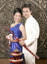 Thai man and woman in silk dress Royalty Free Stock Images