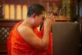 Thai Monk pay respect to the Phra Phuttha Chinnarat Buddha Image