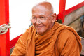 Thai monk in traditional orange clothes Royalty Free Stock Photo