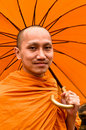 Thai Monk With Umbrella Royalty Free Stock Photo