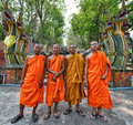 Thai monks wearing the traditional costume and standing before the dragon stairs Stock Image