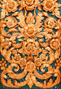 Thai motifs on wall at buddhist church in temple Stock Image