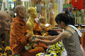 Thai new year songkran shoppers take part in a merit making ceremony in a shopping mall while celebration the on april in hua hin Stock Image