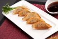 Thai pan fried gyoza dumplings dumpling appetizers with soy dipping sauce Stock Photography