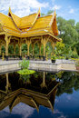 Thai pavilion sala reflected a beautiful or in madison wisconsin sent as a gift from thailand in a pool Stock Image
