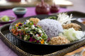 Thai Purple Rice with flower petal salad Stock Photography