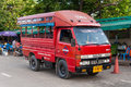 Thai red taxi truck Songthaew bus at Sappawut pier Royalty Free Stock Photo