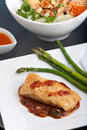 Thai sea bass with asparagus freshly prepared style fish dinner and appetizer a contemporary presentation Stock Photos