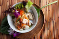 Thai seafood som tum salad traditional dish of freshly prepared food and green papaya Royalty Free Stock Photo
