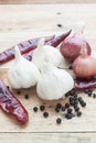 Thai seasoning raw ingredient garlic red chill pepper and onion on wood Stock Photos