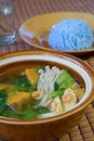 Thai spicy mixed vegetable soup thai food with prawns kang liang and blue rice made from blue pea Royalty Free Stock Image