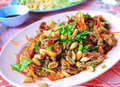 Thai spicy salad with grilled pork and fish Stock Image