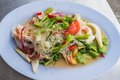 Thai spicy salad style seafood served in restaurant Royalty Free Stock Images