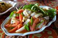 Thai spicy seafood salad in white dish Royalty Free Stock Photos