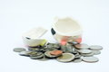 Thai stack coins with broken piggy bank on white background financial concept photo Royalty Free Stock Photos