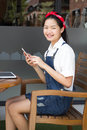 Thai student teen beautiful girl using her smart phone and smile portrait of Stock Photos