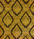 Thai style art of pattern on the door in temple, Thailand. Textu Royalty Free Stock Photo