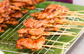 Thai style bbq pork on metal sieve Stock Image