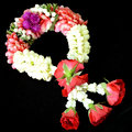 Thai style garland beautiful fresh flower on black background Royalty Free Stock Photo